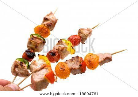 grilled pork kebab in the hand
