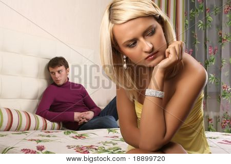 young beautiful woman and man argue in bedroom Stock Photo ...