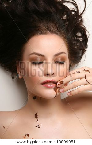 beautiful woman relaxing with melted chocolate