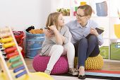 Speech Therapist Working With Child poster