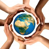 pic of earth  - Conceptual symbol of multiracial human hands surrounding the Earth globe - JPG