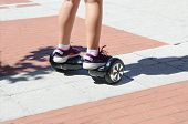 A Girl Riding A Self Balancing Scotter Hoverboard poster