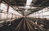 Постер, плакат: Train Moving On City Rail With Motion Blur