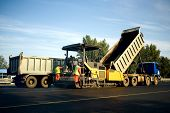 picture of spreader  - Asphalt spreader in work - JPG