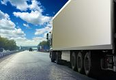 stock photo of semi trailer  - White truck on asphalt road under blue sky with clouds - JPG