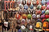 Stand with helmets on bicycle exhibition in showroom poster