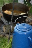 picture of dutch oven  - A dutch oven over an open fire and a coffee kettle - JPG