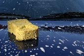 stock photo of car wash  - A car in the process of being washed - JPG