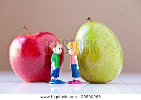 Girl And Boy Discussing Healthy Nutrition (Pear and Apple)