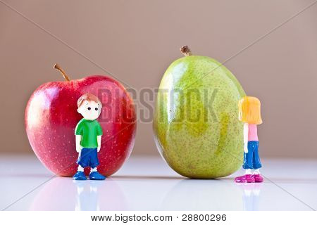 Girl And Boy Arguing Over Healthy Food Choices (Pear and Apple)