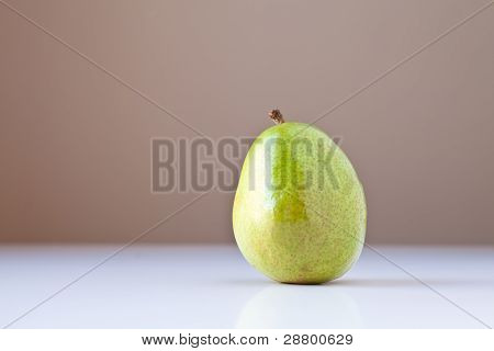 Green Pear On White With Brown Background