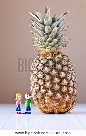 Girl And Boy Discussing Healthy Nutrition (Pineapple)