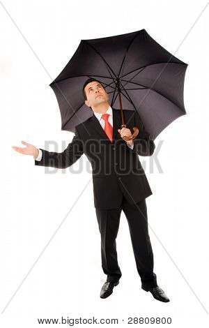 Young business man with an umbrella checking the rain on white background