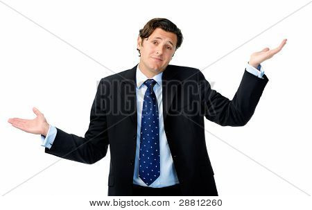 Unsure businessman shrugs his shoulders and throws his hands in the air