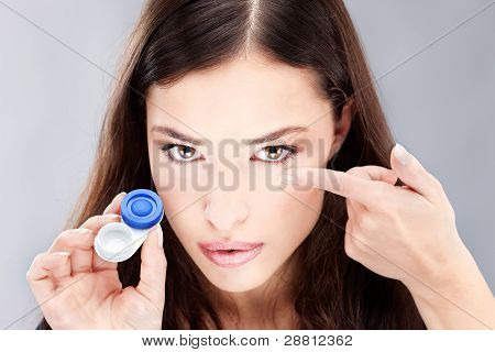 Woman Have Contact Lens On Her Finger