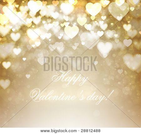 Golden shiny hearts bokeh light Valentine's day background