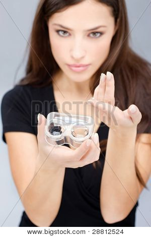 Woman Hold Contact Lenses Cases And Lens
