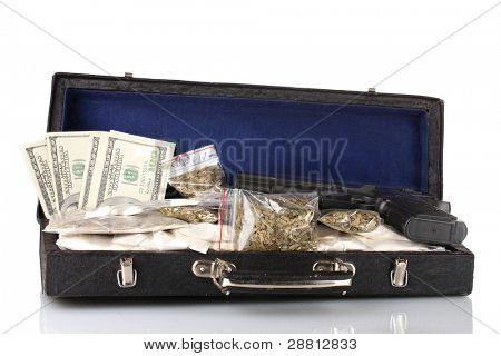 Cocaine and marijuana with gun in a suitcase isolated on white
