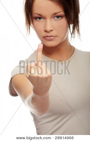 Angry young woman making obscene hand gesture by showing middle finger on white background