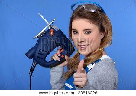A woman holding a jigsaw.