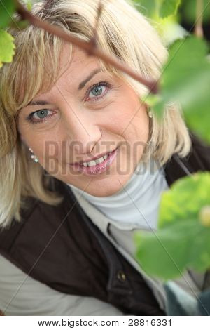 Closeup on a woman's face in a vineyard