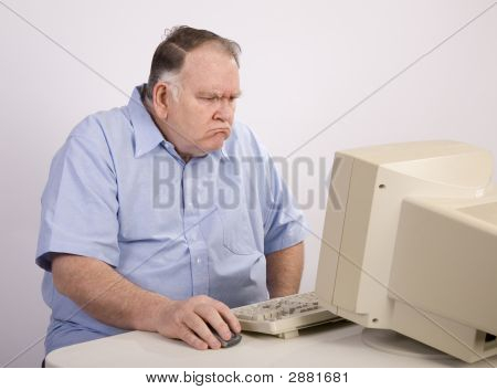 Old Guy At Computer And Grumpy
