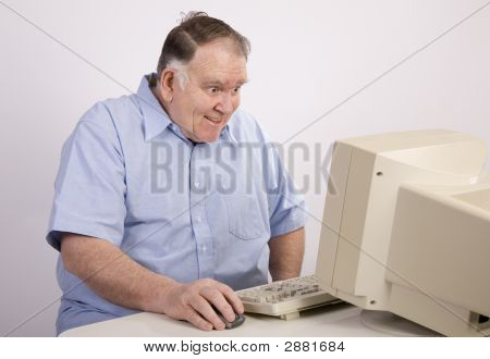 Old Guy At Computer Grinning