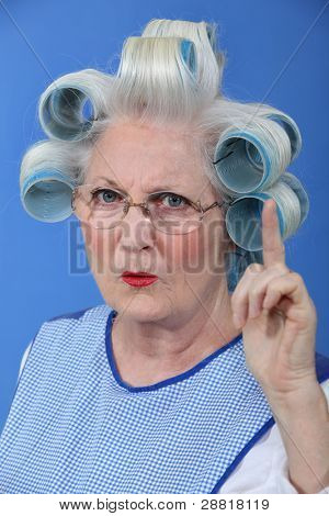 Old woman waving her finger in disapproval