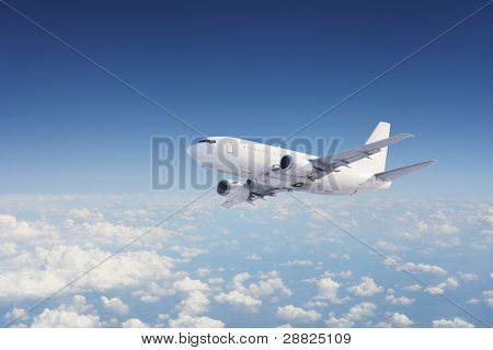 Big Passenger airplane flying over cloudy sky