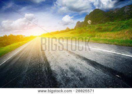 Asphalt road and light on a horizon