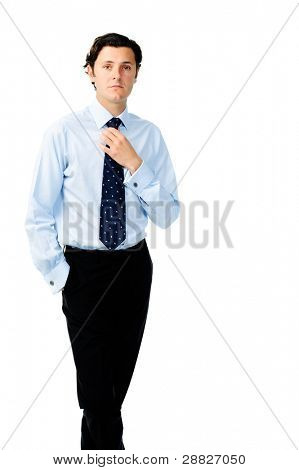 Manager with a straight face adjusting his necktie