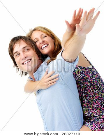 couple pretend they can fly with arms outstretched and big smiling faces