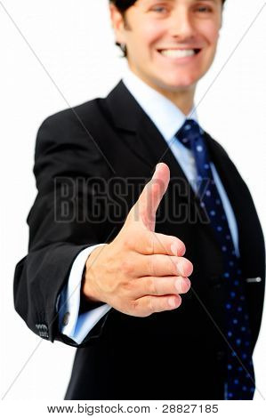 Smiling businessman extends his arm for a congratulatory handshake