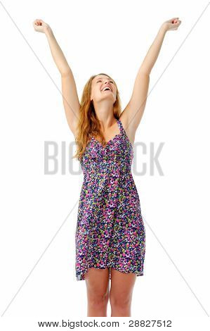 Attractive woman raises her arms overhead in celebration after hearing some good news