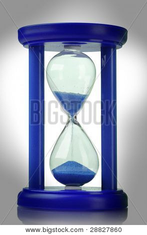 Blue hourglass isolated on white