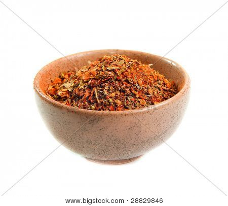 exotic spices in a ceramic bowl isolated on white