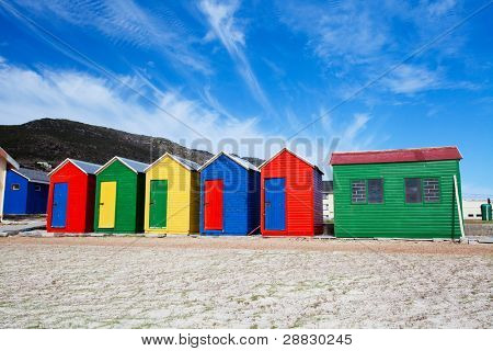 colorful beach cottages on beach in Cape Town, South Africa