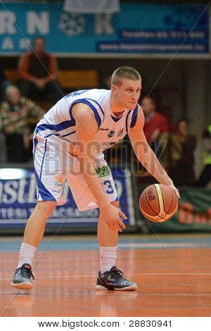 KAPOSVAR, HUNGARY - NOVEMBER 19: Nik Raivio in action at a Hugarian National Championship basketball game Kaposvar (white) vs. Paks (red) November 19, 2011 in Kaposvar, Hungary.