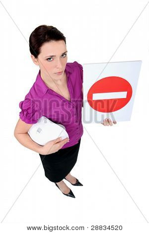 A female architect holding a stop sign.