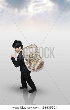 businessman carrying a money bag