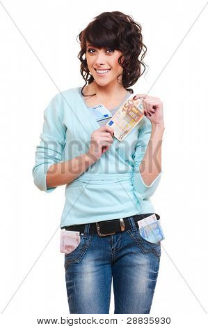 smiley young woman holding euro in her hands. isolated on white background