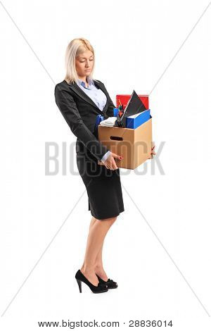Full length portrait of a fired businesswoman in a suit carrying a box of personal items isolated on white background