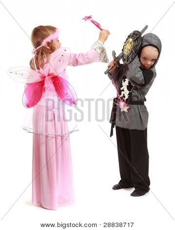 Young girl as magic fairy and boy dressed as a Knight isolated on white