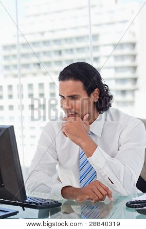 Portrait of a businessman thinking in his office
