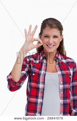 Porträt einer Frau, dass alles in Ordnung vor einem weißen Hintergrund ist Unterzeichnung