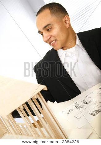 Happy Designer Looking At His Work