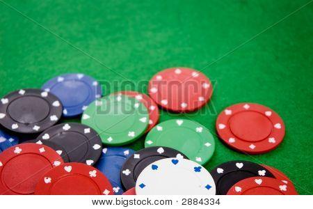 Poker Chips On Green Background
