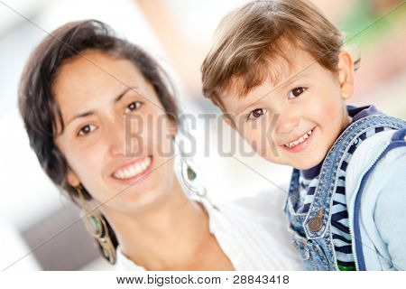 Family portrait with a young mother holding her son and smiling