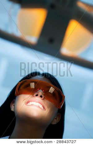 Woman at the dentist wearing laser glasses