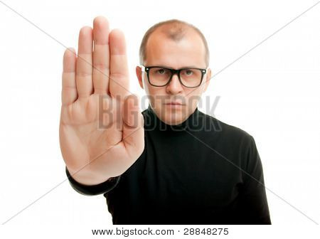 Man in black showing rejective hand gesture, isolated on white